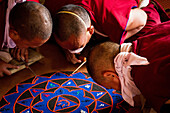 Buddhist monks of the yellow hat tradition making a sand mandala, Gyuto Tantric Monastery, Dharamsala, Himachal Pradesh, India, Asia
