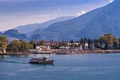 View of ferry leaving the harbour of Riva del Garda, Lake Garda, Trentino, Italian Lakes, Italy, Europe