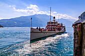 View of ferry boat leaving harbour at Riva del Garda, Riva del Garda, Lake Garda, Trentino, Italian Lakes, Italy, Europe