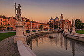View of statues in Prato della Valle at dusk and Santa Giustina Basilica visible in background, Padua, Veneto, Italy, Europe