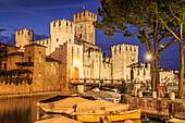 View of Scaliger Castle illuminated at night, Sirmione, Lake Garda, Lombardy, Italian Lakes, Italy, Europe