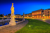 View of statues in Prato della Valle at dusk and Loggia Amulea visible in background, Padua, Veneto, Italy, Europe