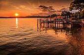 View of golden sunset on Lake Garda, Sirmione, Lake Garda, Lombardy, Italian Lakes, Italy, Europe