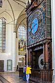 Tourists in front of Astronomical Clock in the Marien Kirche, Rostock, Ostseekueste, Mecklenburg-Vorpommern Germany
