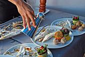 Fish dish in the restaurant La Vaca Azul at El Cotillo, Fuerteventura, Canary Islands, Islas Canarias, Atlantic Ocean, Spain, Europe