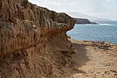 Walk along the cliff towards the Caleta Negra near Ajuy, Fuerteventura, Canary Islands, Islas Canarias, Atlantic Ocean, Spain, Europe