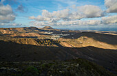 View from the Mirador de Haria at the village of Haria and the Monte Corona, Lanzarote, Canary Islands, Islas Canarias, Spain, Europe