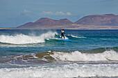 Surfer at the Playa de Famara, Atlantic Ocean, Lanzarote, Canary Islands, Islas Canarias, Spain, Europe