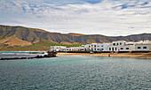 Village of La Caleta de Famara at the foot of the Famara Mountains, Atlantic Ocean, Lanzarote, Canary Islands, Islas Canarias, Spain, Europe