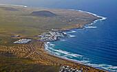 View from the top of the Famara mountains at Caleta de Famara, Atlantic Ocean, Lanzarote, Canary Islands, Islas Canarias, Spain, Europe
