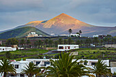 Last sunrays over the mountains at Yaiza, Atlantic Ocean, Lanzarote, Canary Islands, Islas Canarias, Spain, Europe