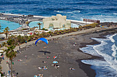 Paraglider landing at the public beach of Puerto de la Cruz, Playa Lago Martianez César Manrique, Tenerife, Canary Islands, Islas Canarias, Atlantic Ocean, Spain, Europe
