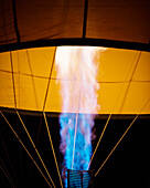 Close-up of a gas burner inflating a balloon in the morning darkness at the Sonoma County Hot Air Balloon Classic.