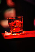 Close up of an alcoholic drink on a table. Soft focus.