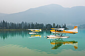 Float planes moored on Green Lake, Whistler, British Columbia, Canada