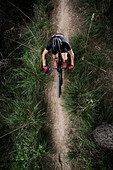 View from above of mountain biker, La Sentiu, Barcelona, Catalonia, Spain