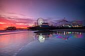 Amusement park and Santa Monica Pier at sunset, Los Angeles, California, USA