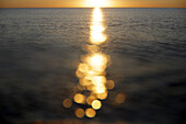Sunlight reflecting on sea surface at sunset, Murcia, Spain