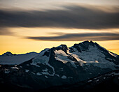 Scenery with snow-covered mountains at sunset seen from Whistler Mountain, Garibaldi Provincial Park, Whistler, British Columbia, Canada