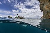 Thai longtail boat in water and woman diving underwater, Tambon Ko Tarutao, Chnag Wat Krabi, Thailand