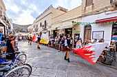 Parade of traditional costumes and flags, Favignana island, Aegadian Islands, province of Trapani, Sicily, Italy, Europe