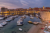 Elevated view over the port and the old town at dawn, UNESCO World Heritage Site, Dubrovnik, Croatia, Europe