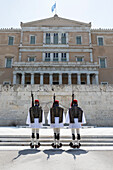 Changing of the Guard at the Tomb of the Unknown Soldier in Syntagma Square with the Old Royal Palace, Athens, Greece, Europe