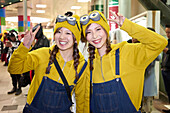 Young Japanese girls dressed as Minions at the Halloween celebrations in Shibuya, Tokyo, Japan, Asia