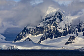 Glaciers and mountains of Cape Errera with dramatic sky, Wiencke Island, from Bismarck Strait, Antarctic Peninsula, Antarctica, Polar Regions