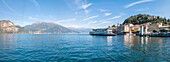 Panoramic aerial view of ferry boat at Bellagio on the shore of Lake Como, Province of Como, Lombardy, Italian Lakes, Italy, Europe (Drone)