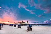 Beach chairs and pier at sundown, Ahlbeck, Usedom island, Mecklenburg-Western Pomerania, Germany