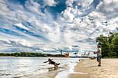 Man and dog at beach, Swinemünde, Usedom, Poland