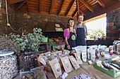 woman and man, market stall, local delicatessen, livestock fair in San Antonio del Monte, Garafia region, UNESCO Biosphere Reserve, La Palma, Canary Islands, Spain, Europe
