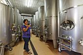 worker, woman, stainless steel tanks, wine, Bodega El Nispero, El Castillo, Garafia region, UNESCO Biosphere Reserve, La Palma, Canary Islands, Spain, Europe