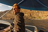 captain, man, boat excursion from Puerto de Tazacorte, excursion boat Fantasy, sea, Atlantic, UNESCO Biosphere Reserve, La Palma, Canary Islands, Spain, Europe