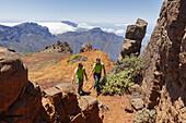 men jumping with the canarian crook, Salto del Pastor Canario, crater rim, Caldera de Taburiente, UNESCO Biosphere Reserve, La Palma, Canary Islands, Spain, Europe