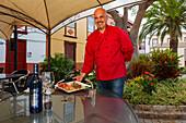 Chef with plate, food, Restaurante Cafeteria La Placita, San Andres, San Andres y Sauces, UNESCO Biosphere Reserve, La Palma, Canary Islands, Spain, Europe