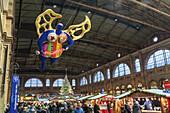 Christmas market Zurich main station, guardian angel by Niki de St. Phalle, Zurich, Switzerland