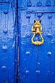 Blue entrance door and door knocker. Venta del Quijote. Puerto Lapice, Ciudad Real province, Castilla La Mancha, Spain Europe.