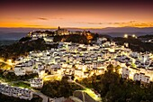 Panoramic at dusk. White village of Casares, Malaga province Costa del Sol. Andalusia Southern Spain, Europe.