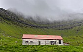 Sheep shelter on Kalsoy. Nordoyggjar (Northern Isles) in the Faroe Islands, an archipelago in the north atlantic. Europe, Northern Europe, Scandinavia, Denmark, Faroe Islands.