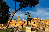 Rome, Italy. Statue of the Emperor Trajan with Trajan's Forum behind. The Historic Centre of Rome is a UNESCO World Heritage Site.