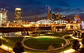 Twilight over Cumberland Park and the skyline of Nashville, Tennessee, USA.