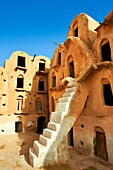 Ksar Ouled Soltane, a traditional Berber and Arab fortified adobe vaulted granary cellars, or ghorfas, situated on the edge of the northern Sahara in the Tataouine district. Tunisia, Africa. Used as a film set Star Wars: The Phantom Menace as the slave qu