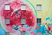 Health centre ( Centro de Salud ) painted with images to promote a healthy lifestyle in Santa Cruz de Tenerife, Canary Islands, Spain.