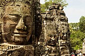 Face towers of the Bayon temple, In the center of Angkor Thom , Siem Reap, Cambodia. UNESCO World Heritage Site. Capital city of the Khmer empire built at the end of the 12th century.