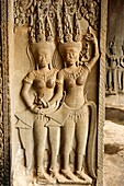 Sculpture of apsaras and carved pillar. Angkor Wat, Siem Reap, Cambodia. Largest religious monument in the world 162. 6 hectares. UNESCO World Heritage.