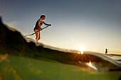 Stand Up Paddler on Lake Starnberg,  Lake Starnberg, Bavaria, Germany