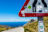 A cyclist on the famous winding road leading to Torrent de Pareis, Sa Calobra, Tramuntana Mountains, Mallorca, Spain