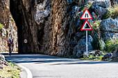 A cyclist on the famous winding road leading to Torrent de Pareis, Sa Calobra, Tramuntana Mountains, Mallorca, Spain